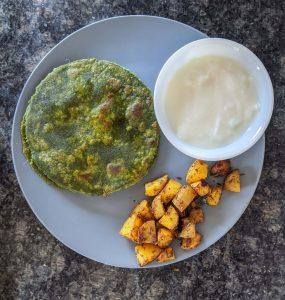 Palak Paratha|Spinach flatbread with curd, and roasted potatoes