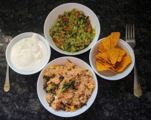 Mexican rice/Spanish rice - Served with Chips, Sour Cream, Guacamole